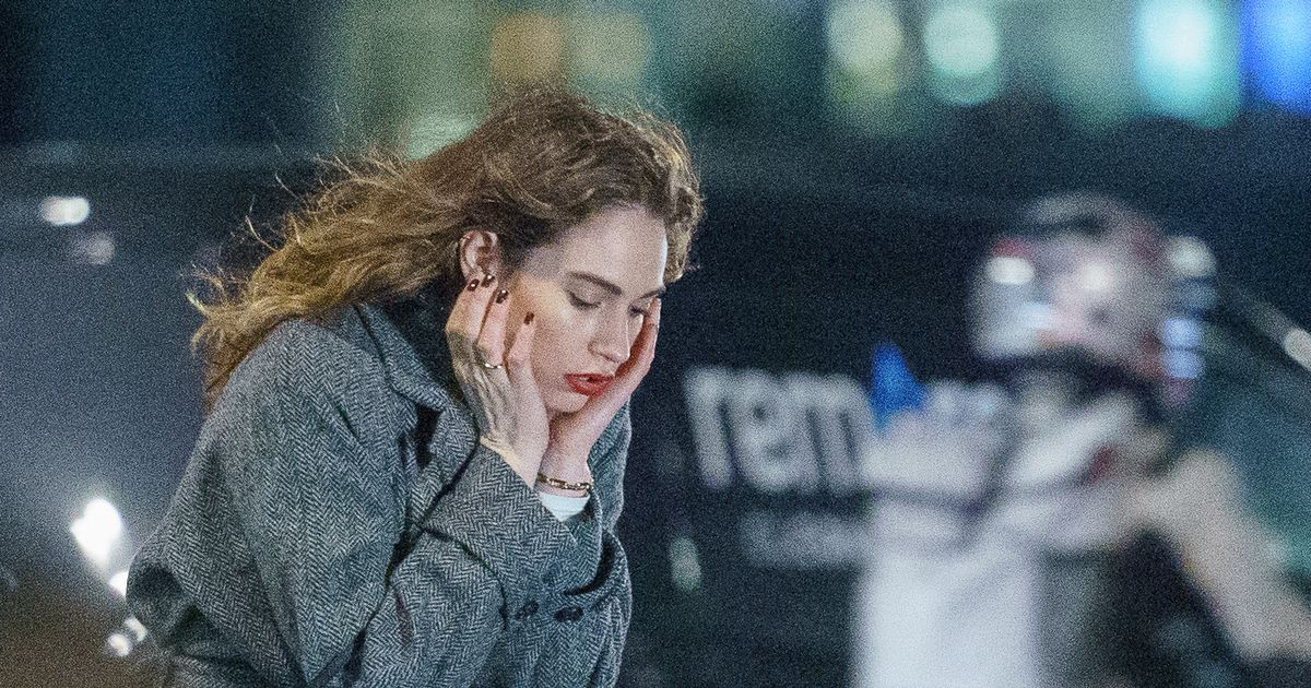 Lily James looks miserable as she gets back to work filming in freezing London