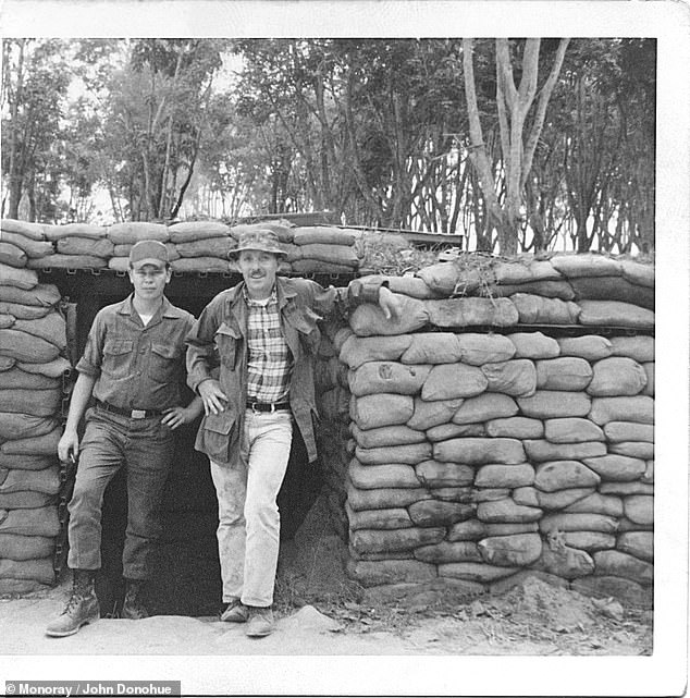 Donohue, pictured with another soldier during his trip to Vietnam between 1967 and 1968