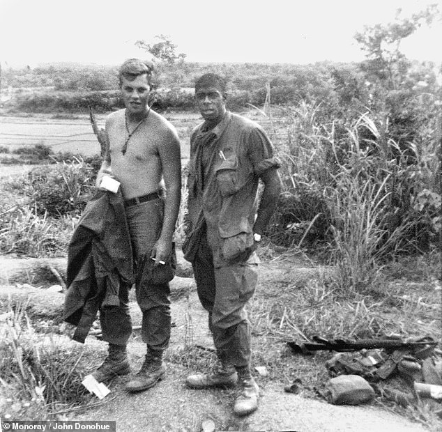 Donohue's friend Ricky Duggan, left, and one of his fellow soldiers during the Vietnam War. Both men could not believe Donohue had traveled all this way to deliver them beer