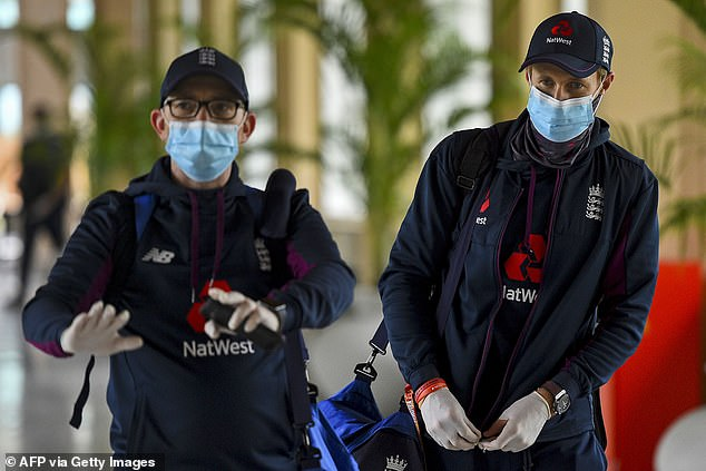 England captain Joe Root (right) wears a mask as the touring party arrive for the two-Test tour