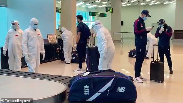 Officials in protective clothing were on hand to disinfect the England team's luggage