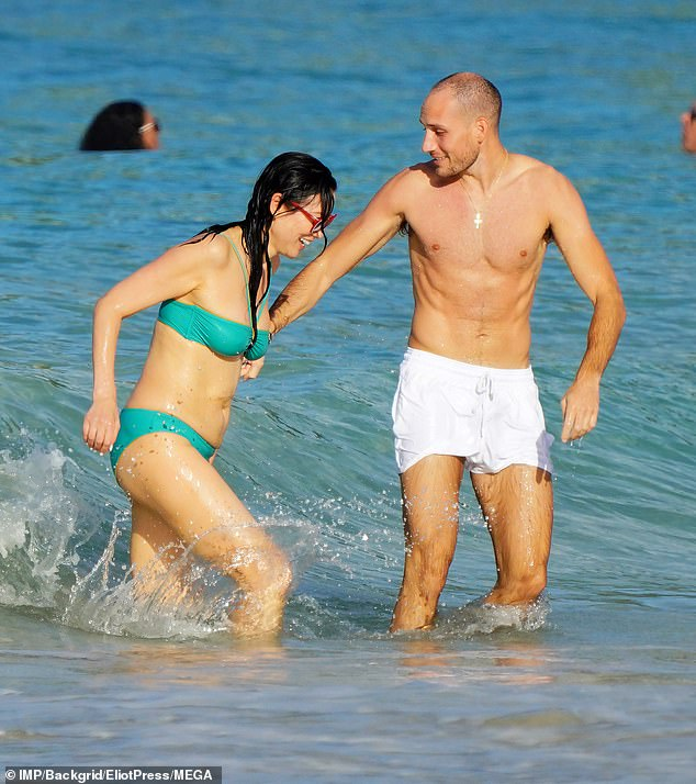 Fun and frolics: Her outing came days after she was sen looking sensational in a turquoise bikini as she frolicked and larked around with her companion on Monday