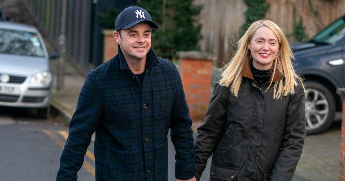Newly-engaged Ant McPartlin and Anne-Marie Corbett hold hands after proposal