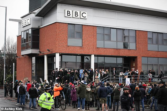 Demonstrators claimed the Covid vaccine was in fact 'hydrogen with a bio sensor' as they stood outside the BBC headquarters