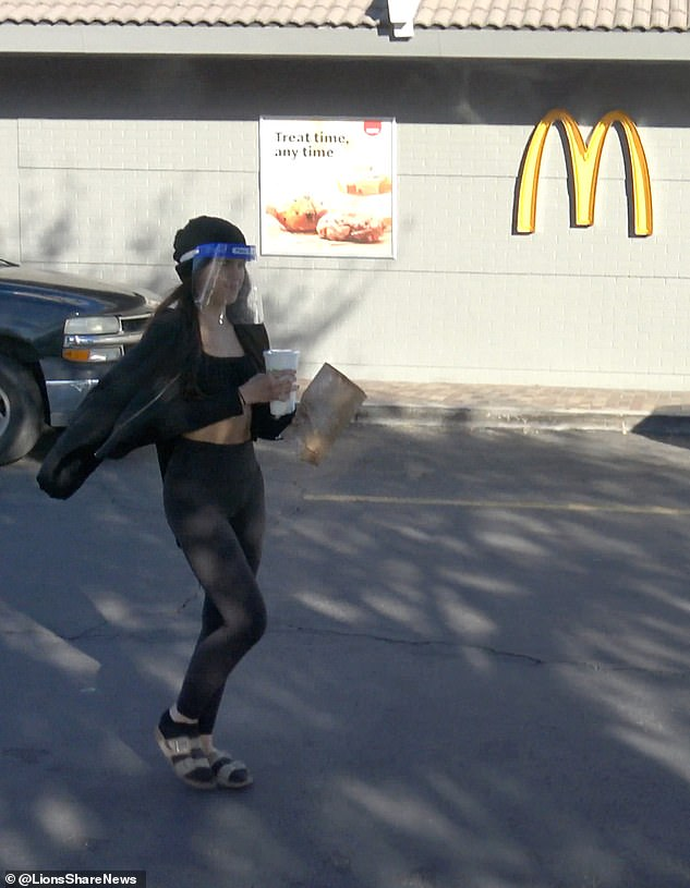 The 22-year-old from Southern California would be seen looking very happy with herself as she brought a McDonald's order back to her car