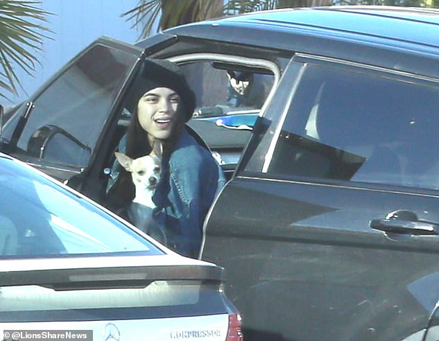 Miya was seen with her dog at one point as she got out of the family's Range Rover car as she arrived home