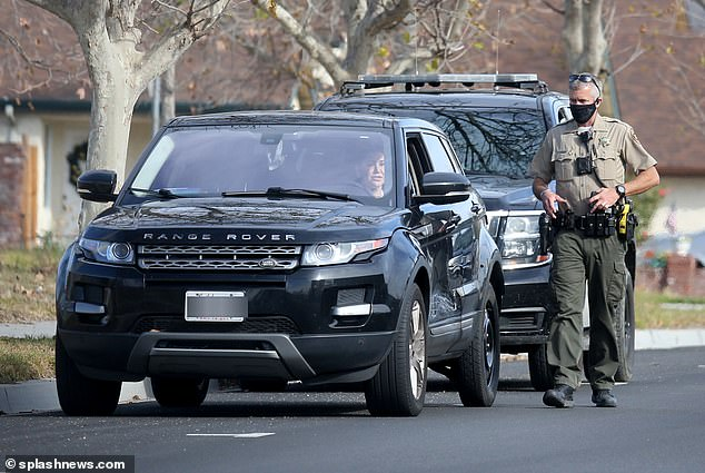 The mother of 'Soho Karen' Miya Ponsetto, Nicole Ponsetto, is spotted talking to cops from her Range Rover a few miles from her home