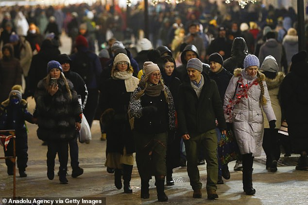 Thousands flocked to the streets of Moscow on New Year's Eve to watch the fireworks