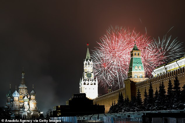 Fireworks go off over Moscow's Red Square marking the beginning of 2021