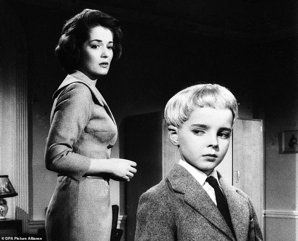 Barbara Shelley and Martin Stephens in the 1960 classic Village of the Damned from Anglo-German director Wolf Rilla