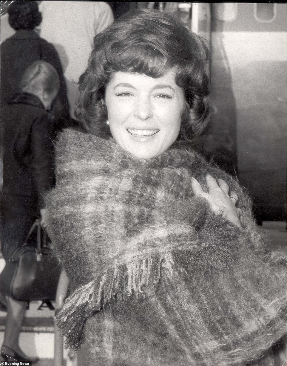 Shelley wrapped up warm in a large scarf against the cold outside a film premiere back in 1967, the height of her stardom