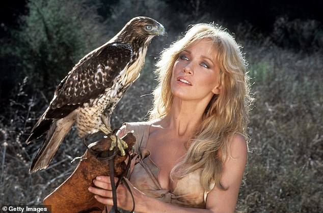 Another hit on her hands: Roberts holding a perch with a bird on it in a scene from the film Sheena: Queen of the Jungle, 1984