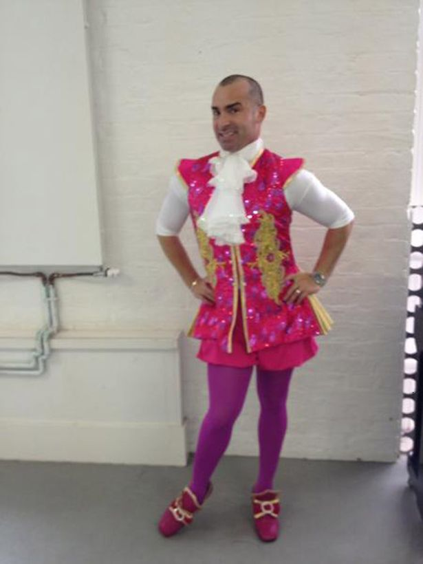 Louie Spence dressed in a pantomime costume