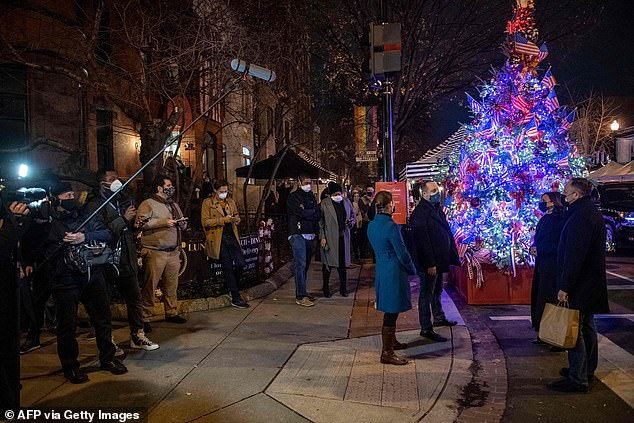 Harris and Emhoff picked up take-out from Floriana, the restaurant that boasts a Harris-themed Christmas tree out front, as a gaggle of reporters watched