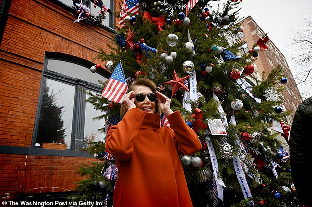 House Speaker Nancy Pelosi visits the 'Pelostree' in front of Floriana in Washington, D.C.'s, Dupont Circle neighborhood in December 2018