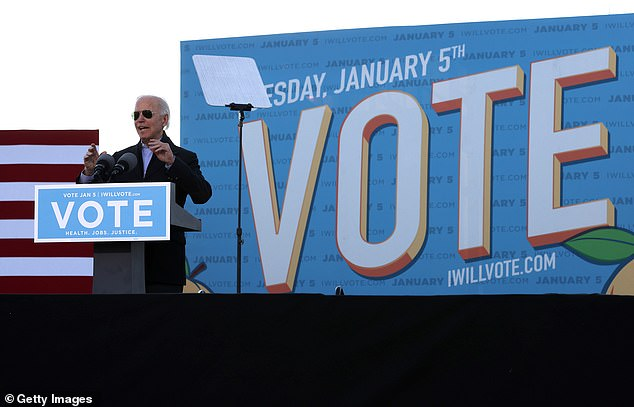 Biden arrived at the Atlanta rally sporting his trademark aviator sunglasses. Voters in the state cast ballots in two Senate run-off races on Tuesday