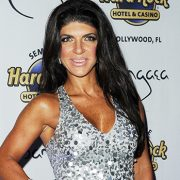 Teresa Giudice, 48, Rocks Sexy Plunging Mini Dress While Cozying Up To BF Louie Ruelas On NYE