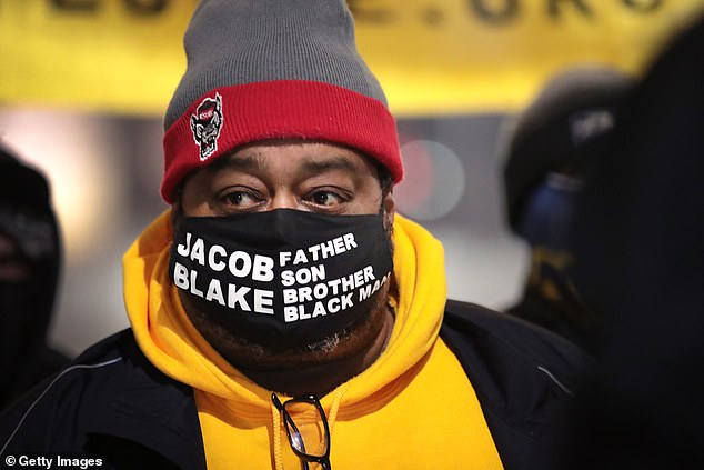 Jacob Blake Sr., the father of Jacob Blake Jr., attends a vigil near the Kenosha County Courthouse on January 4