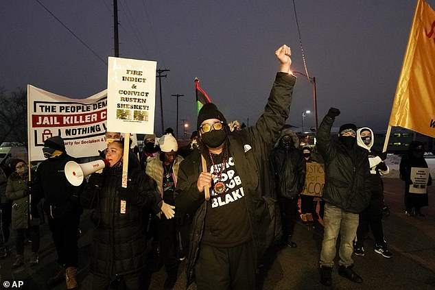 Justin Blake, uncle of Jacob Blake, leads a march Monday, January 4, 2021, in Kenosha, Wisconsin. Kenosha Police Officer Rusten Sheskey opened fire on Jacob Blake in August after responding to a domestic dispute, leaving him paralyzed