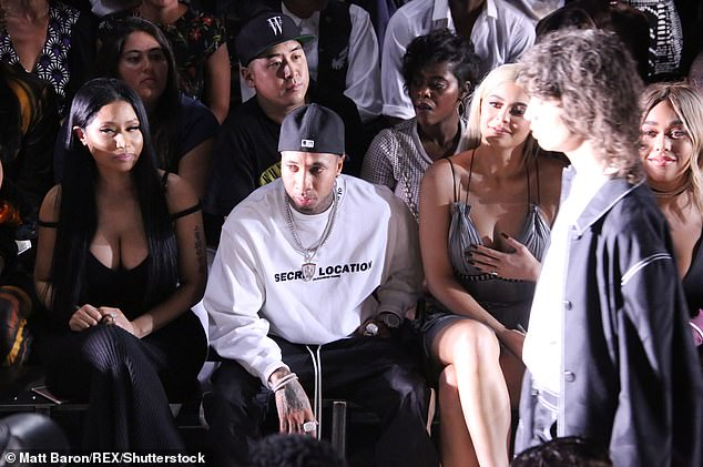 Fan: The 38-year-old Grammy-nominated rapper (L), in particular, was known to have worn his clothing and held court in the front row of his fashion presentations (pictured in 2016)