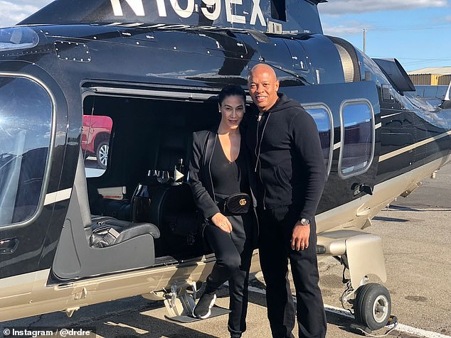 Dr Dre and his wife Nicole Young are pictured on their 22nd anniversary. They are divorcing