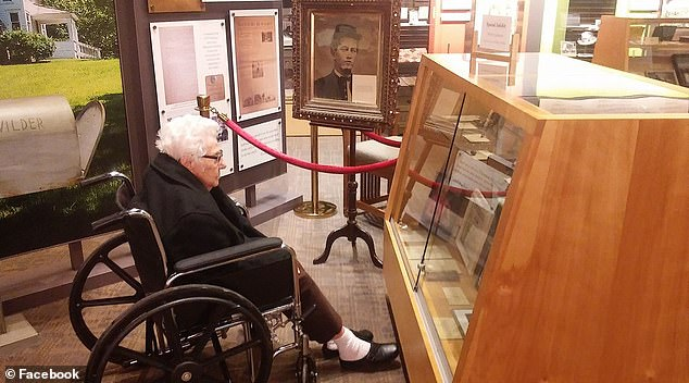 Jackson in January 2019 examining an exhibit dedicated to herat the Laura Ingalls Wilder Home and Museum in Mansfield, Missouri