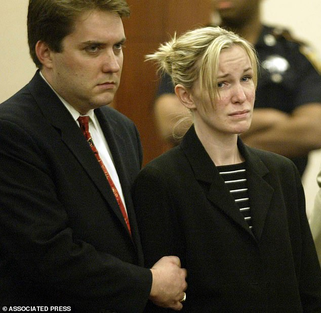 Susan Wright reacts to the verdict of the jury in Houston as her defense Attorney Neal Davis holds her arm in 2004