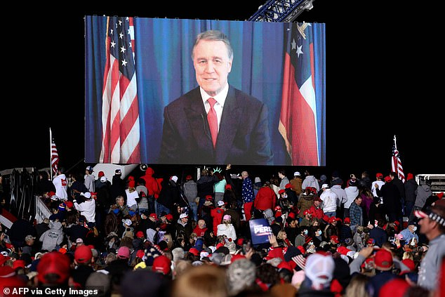 Perdue joined the rally remotely to address the crowd at one point. He is still quarantining at his home after contracting coroanvirus