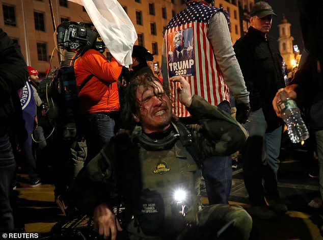 A Trump supporter is seen recovering from being tear gassed as protests turned violent