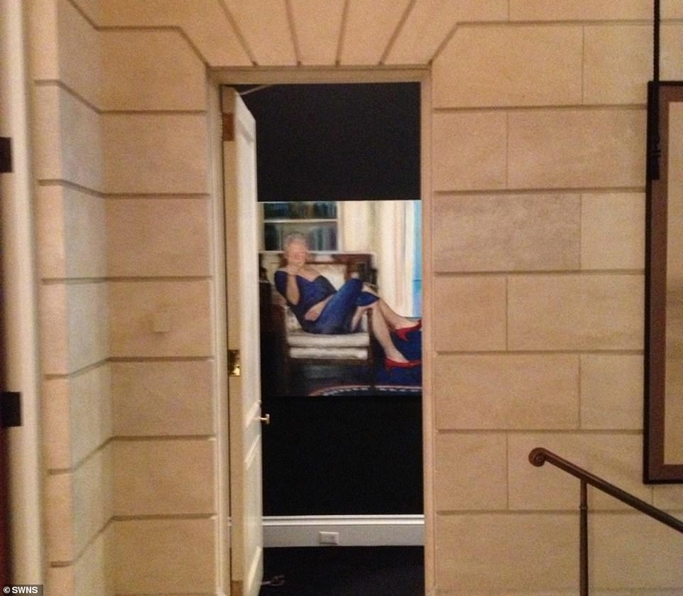 Epstein also reportedly hung a bizarre oil paining of Bill Clinton in a blue dress inside his seven story mansion