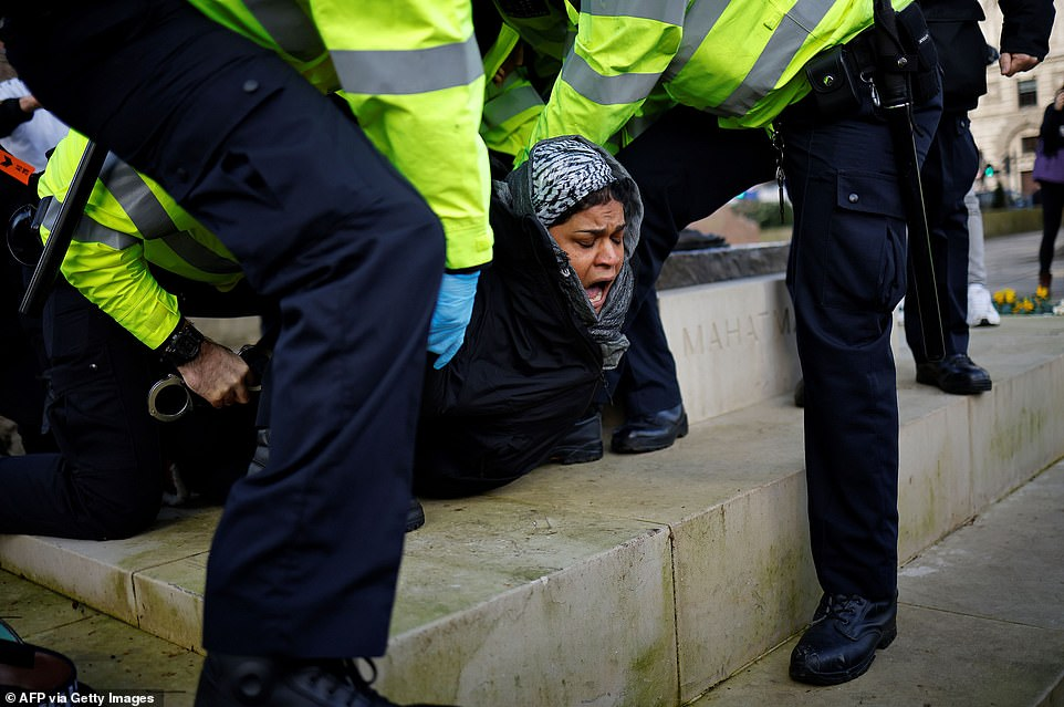Protesters yelled as they were surrounded and arrested after officers asked them to leave area around Parliament Square.  One was pinned down and cuffed on the plinth under the statue of Mahatma Gandhi