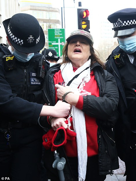 Supporters of Julian Assange were also taken away after police said they ignored repeated warnings not to gather