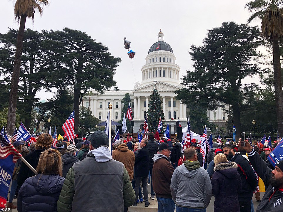 SACRAMENTO: Hundreds also gathered outside of California's Capitol building on Wednesday, waiving Trump and US flags