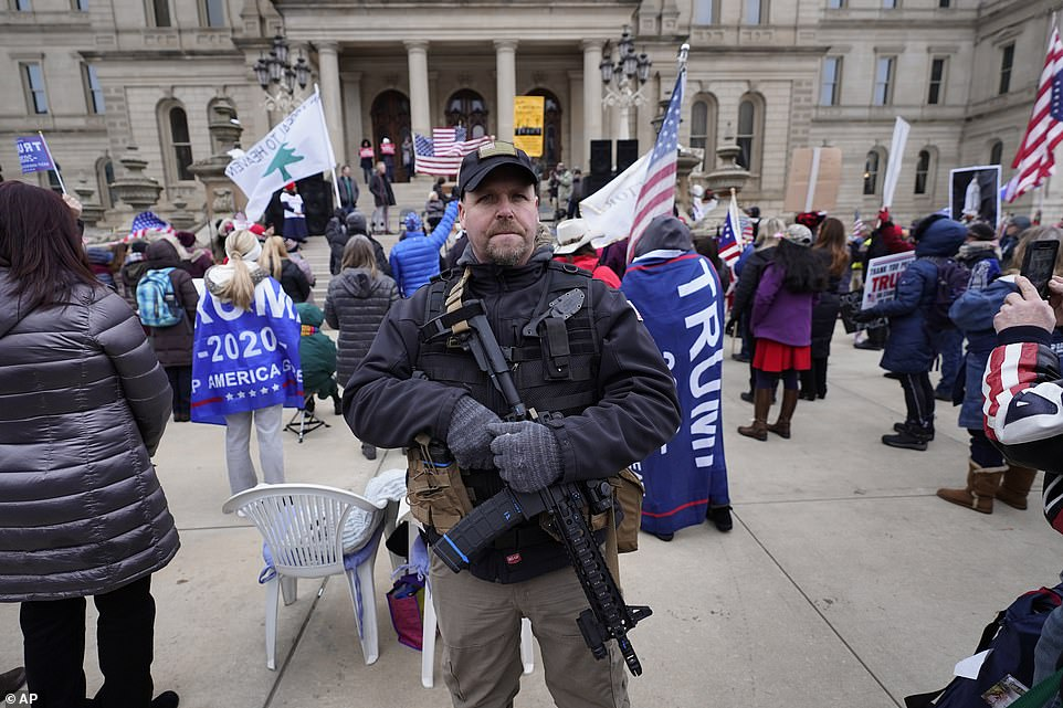 MICHIGAN: A several hundred strong crowd gathered in Lansing, Michigan also Wednesday, may weilding rifles