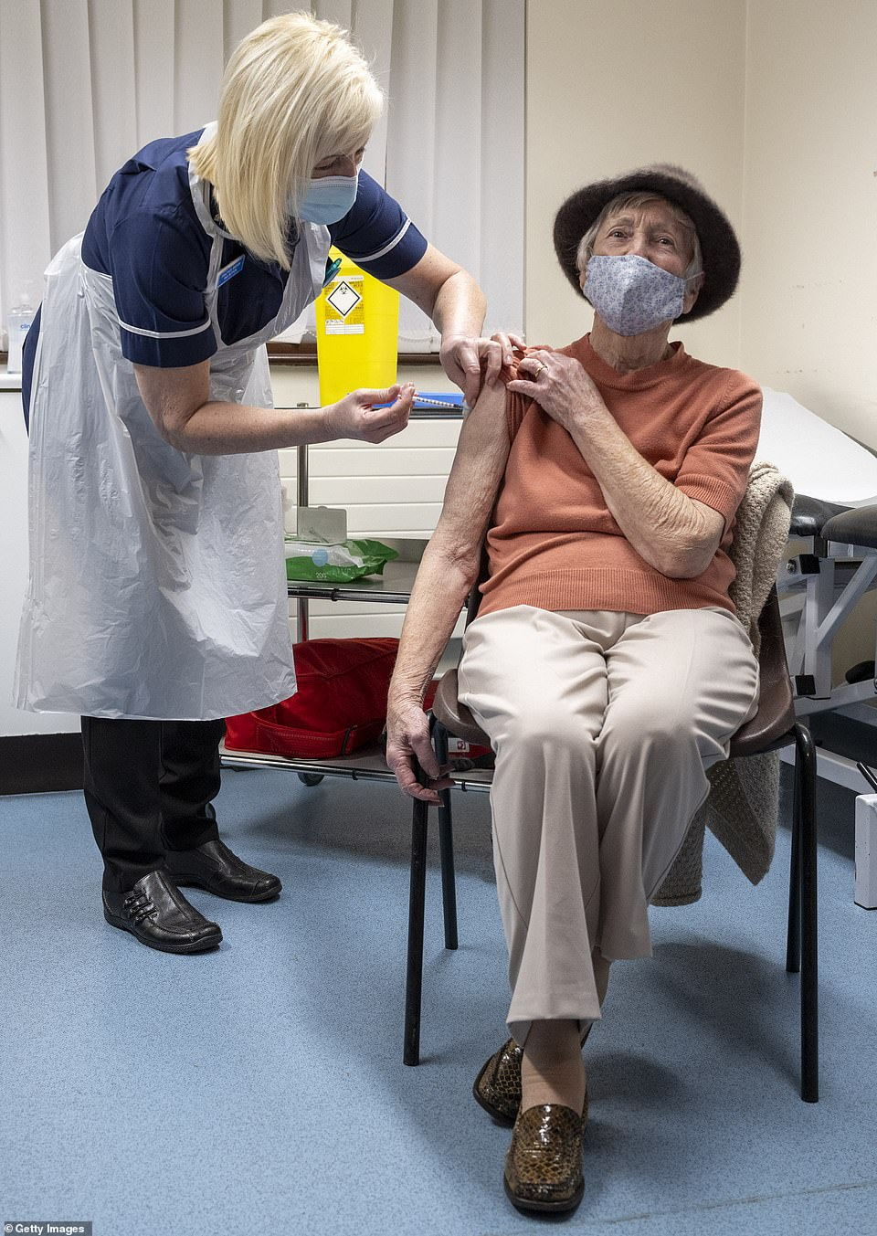 A nurse administers the Oxford-AstraZeneca vaccine to a patient at Pontcae Medical Practice on January 4 in Merthyr Tydfil, Wales. The Oxford-AstraZeneca COVID-19 vaccine was administered at a handful of hospitals before being rolled out to hundreds of GP-led sites across the country