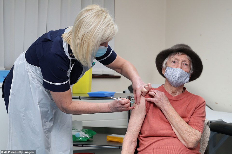 Eight months ago, when the nation was still in the grip of the first wave, Business Secretary Alok Sharma insisted sufficient doses would be ready. Pictured, a dose is administered to Pat Hier at the Poncae Medical Practice in Merthyr Tydfil