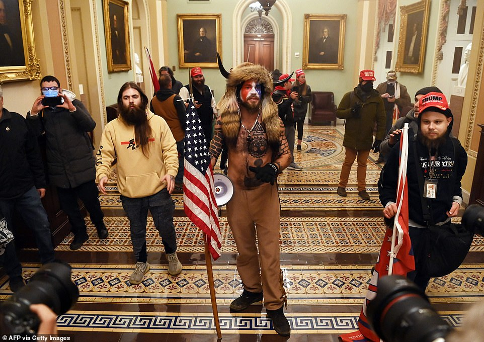 Trump supporters stand in the Capitol before storming the House Chamber on Wednesday afternoon