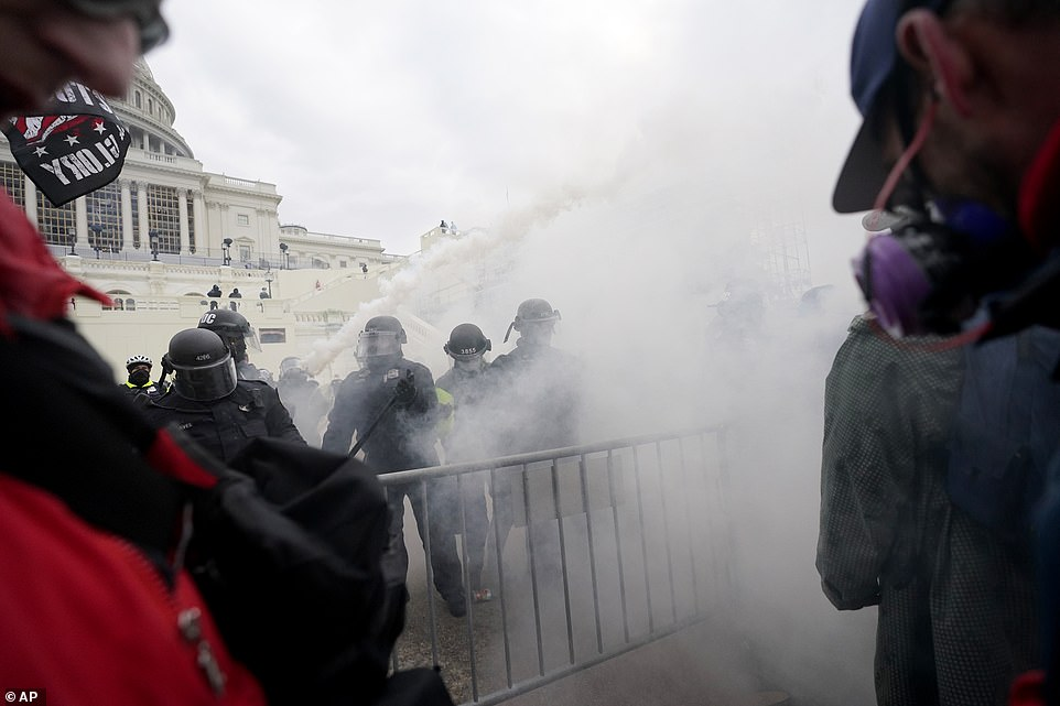 Capitol Police spray tear gas at Trump supporters as they try to break through a police barrier