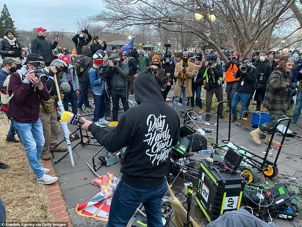 Journalists and TV crews were forced to abandon the area and flee as the violent thugs wielding sticks pushed over a barricade and entered the area they had set up in