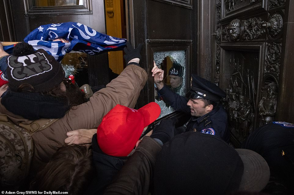 Police try to hold back protesters pushing into a doorway at the Capitol on Wednesday