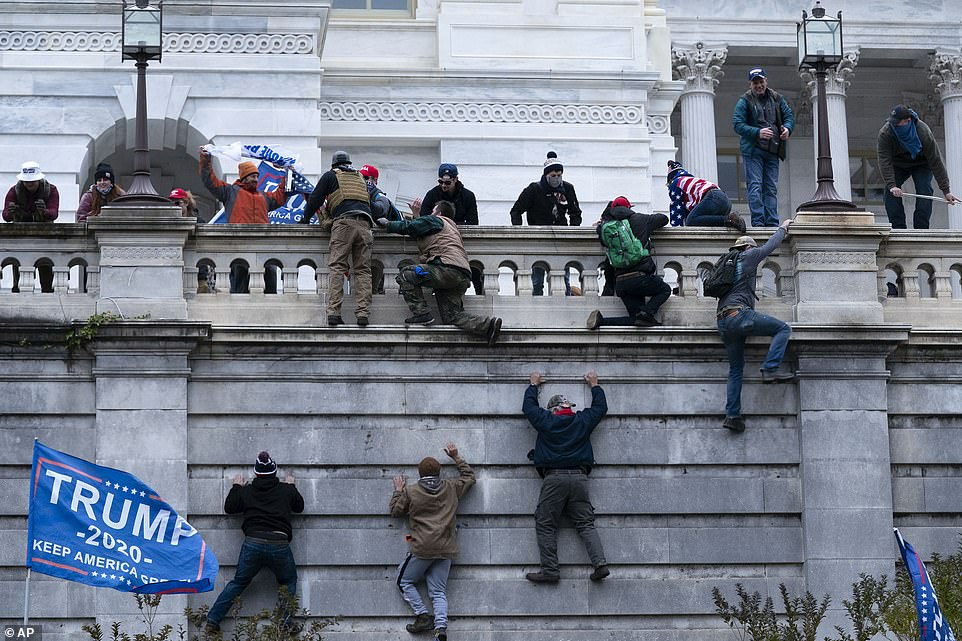 Trump rioters scale the walls of the US Capitol Building after storming past police