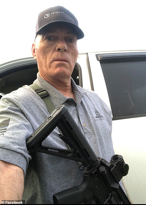 In one selfie on his Facebook page, Barnett is seen posing with a semi-automatic rifle