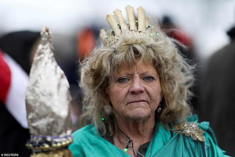 Leigh Ann Luck dressed up as Statue of Liberty poses for a picture as supporters of Donald Trump protested Biden's victory