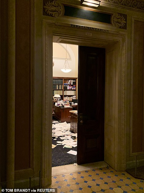 Papers were strewn over the carpet of a parliamentarian's office