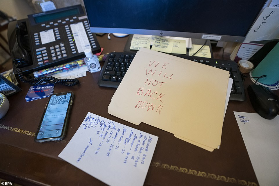 Speaker Nancy Pelosi's suite of offices were targeted by the rioters who smashed a mirror, cracked the Democrat's nameplate and left a menacing message scrawled on a file: 'WE WILL NOT BACK DOWN'