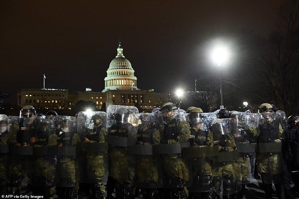 Riot police prepare to move demonstrators away from the Capitol as authorities struggled to restore order on Wednesday