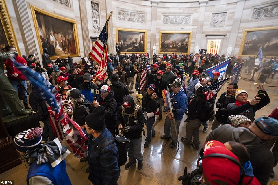 Supporters of Donald Trump gather in the Capitol Rotunda, shouting slogans as they try to overturn the election result