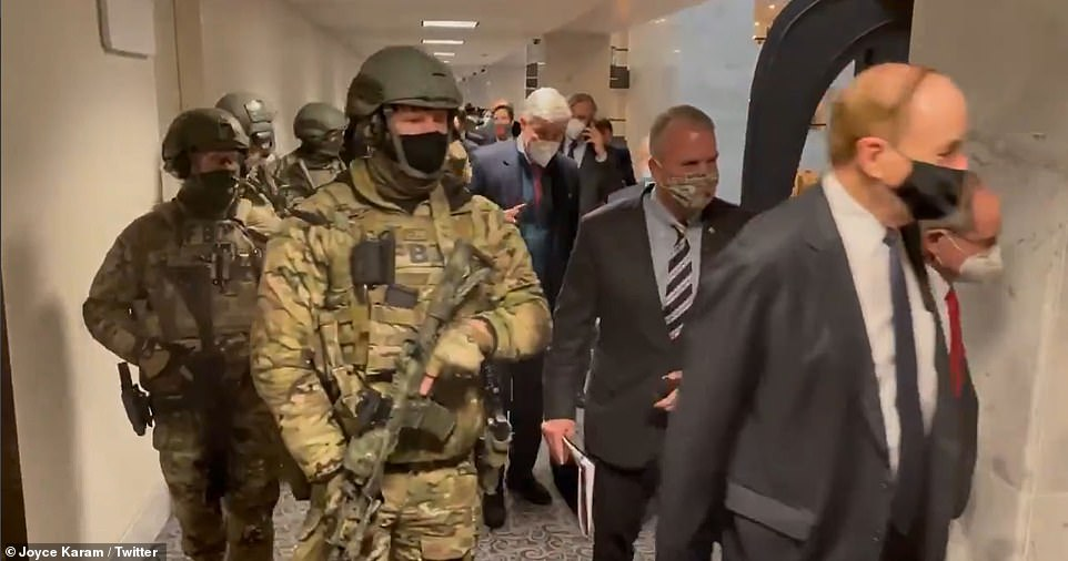 The lawmakers were seen flanked by armed guards as they made their way into the Capitol