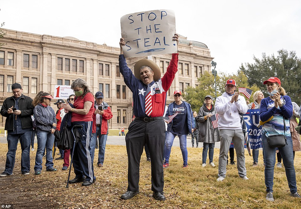 TEXAS:Jack Finger, of San Antonio, protests the election with supporters of President Donald Trump Wednesday, Jan. 6, 2021, at the Capitol in Austin