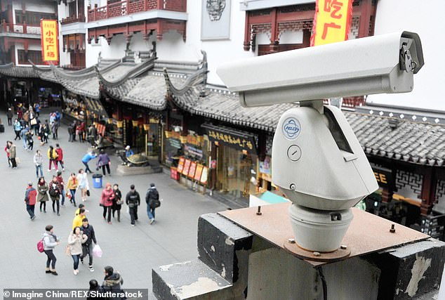 In financial hub Shanghai (pictured), every 8.8 residents are watched by one security camera